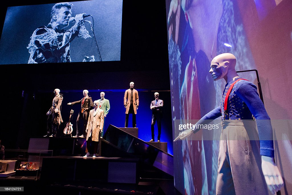A suit from the 'Diamond Dogs' tour worn by musician and actor David Bowie is displayed at the 'David Bowie is' exhibition at the Victoria and Albert (V&A) museum in central London on March 20, 2013. Running March 23 to August 11, the exhibition features more than 300 objects that include handwritten lyrics, original costumes, fashion, photography, film, music videos, set designs and Bowie's own instruments. AFP PHOTO/Leon Neal
