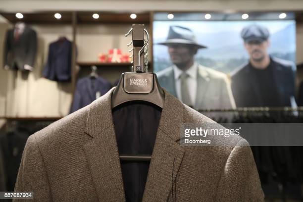 A suit jacket hangs on display inside a branch of Marks Spencer Group Plc in London UK on Tuesday Dec 5 2017 Brexit uncertainty and an increase in...