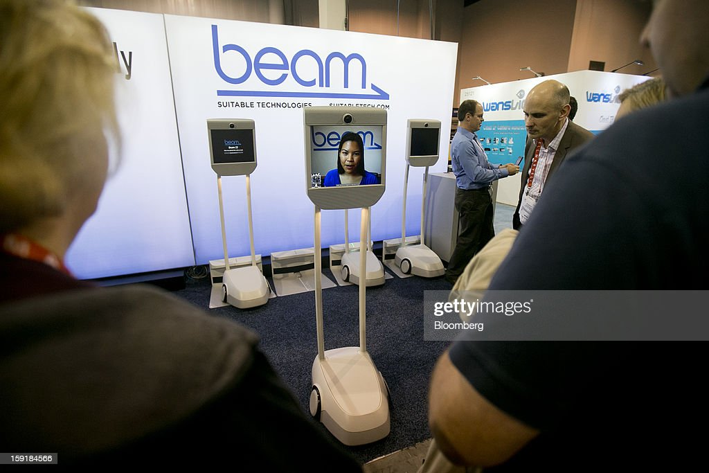 A Suitable Technologies 'Beam' remote presence system interacts with attendees during the 2013 Consumer Electronics Show in Las Vegas, Nevada, U.S., on Wednesday, Jan. 9, 2013. The 2013 CES trade show, which runs until Jan. 11, is the world's largest annual innovation event that offers an array of entrepreneur focused exhibits, events and conference sessions for technology entrepreneurs. Photographer: Andrew Harrer/Bloomberg via Getty Images