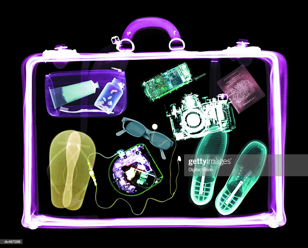 Suitcase and contents : Stock Photo