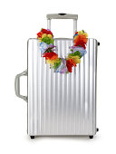 Suitcase and garland of flowers