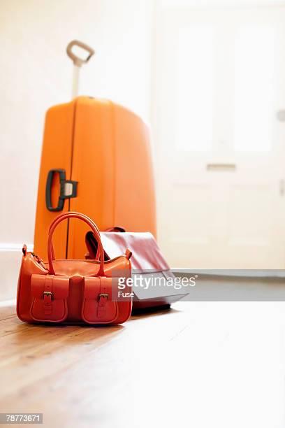 Suitcase and Handbag in Corridor