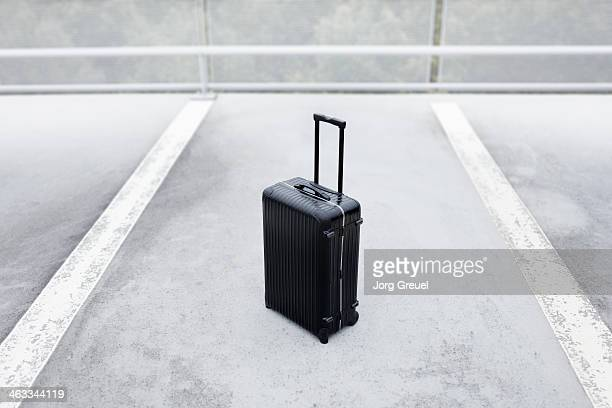 Suitcase in a parking space