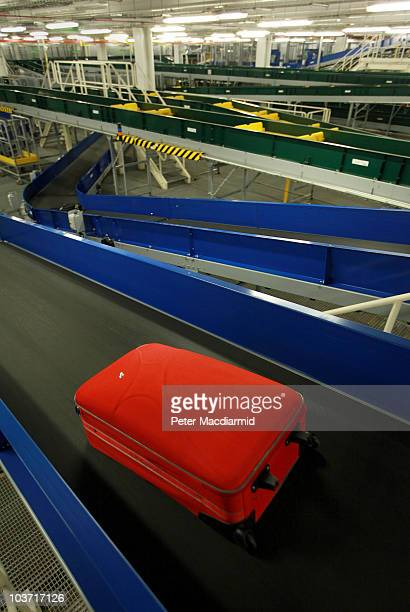 A suitcase passes along a conveyor belt at Terminal five's automated baggage handling system at Heathrow on August 27 2010 in London England...