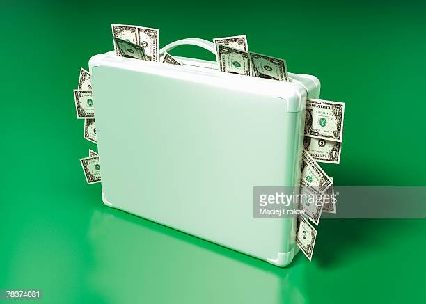Suitcase stuffed with cash