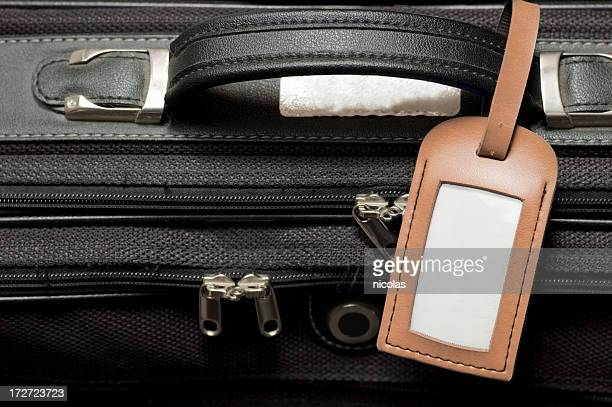 Suitcase with blank Luggage Tag