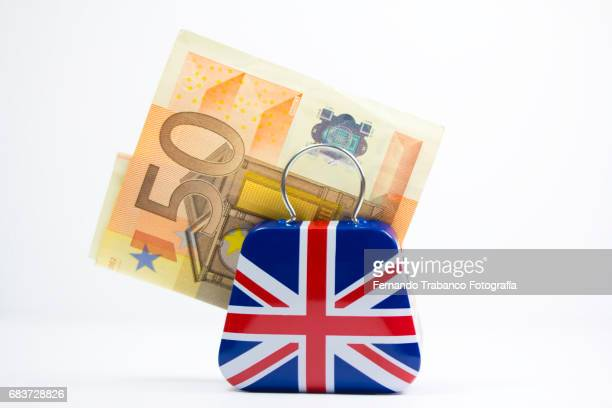 Suitcase with the English flag full of money to leave Europe for the brexit