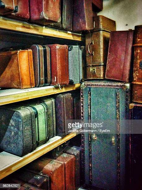 Suitcases Arranged On Shelf At Home