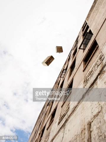 suitcases being thrown from a building : ストックフォト