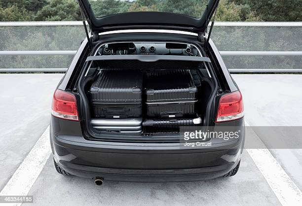 Suitcases in a car trunk