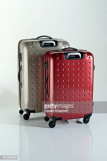 2 suitcases on a white background