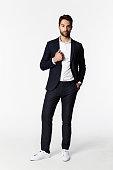 Portrait of man in suit, studio