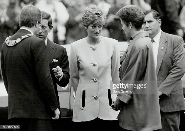 Suited up Princess Diana wore pink and black suit above left to Nathan Phillips Square She arrived in Toronto in black white and red houndstooth...
