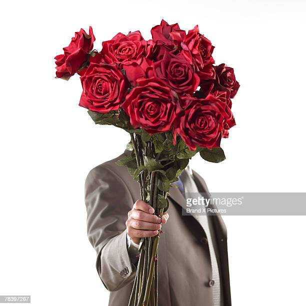 Suitor with bouquet of roses