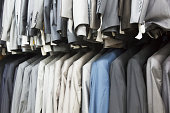 Suits Hanging In Rows In A Clothing Shop