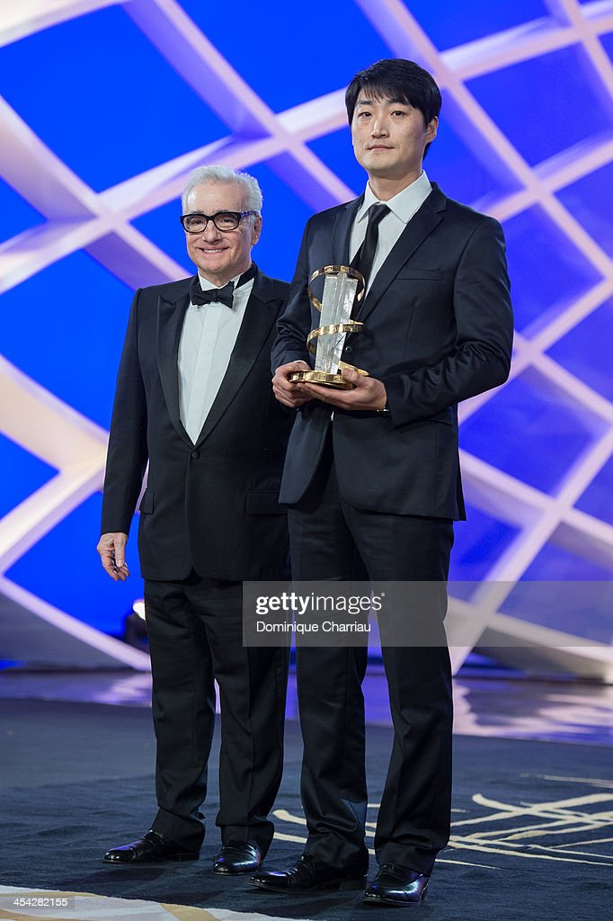 Su-jin Lee poses with Jury President <a gi-track='captionPersonalityLinkClicked' href=/galleries/search?phrase=Martin+Scorsese&family=editorial&specificpeople=201976 ng-click='$event.stopPropagation()'>Martin Scorsese</a> after he receives the gold star award during the Award Ceremony of the 13th Marrakech International Film Festival on December 7, 2013 in Marrakech, Morocco.