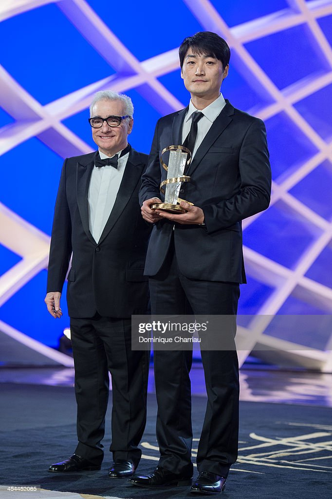 Su-jin Lee poses with Jury President Martin Scorsese after he receives the gold star award during the Award Ceremony of the 13th Marrakech International Film Festival on December 7, 2013 in Marrakech, Morocco.