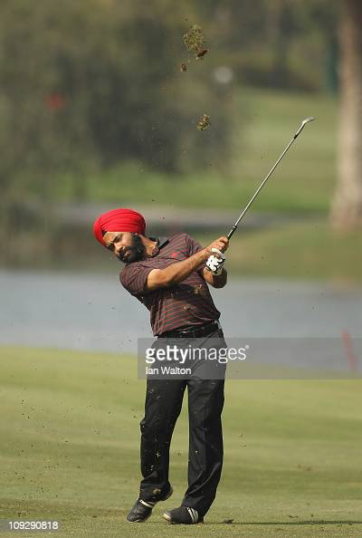 Sujjan Singh of India hits aniron shot during the third round of the Avantha Masters held at The DLF Golf and Country Club on February 19 2011 in New...