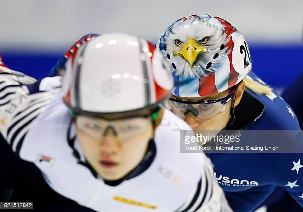 Suk Hee Shim of Korea is chased down by Jessica Kooreman of the United States in the women's 1000 meter quarter final during the ISU World Cup Short...