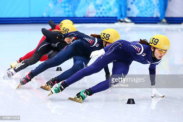 Suk Hee Shim of South Korea leads the pack in the Short Track Women's 1000m Final A on day fourteen of the 2014 Sochi Winter Olympics at Iceberg...