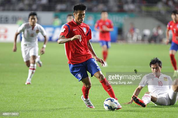 Suk HyunJun of South Korea compete for the ball with Sayavutthi Khampheng of Laos during the 2018 FIFA World Cup Qualifier Round 2 Group G match...