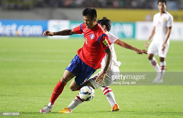 Suk HyunJun of South Korea compete for the ball with Sibounhuang Thotnilath of Laos during the 2018 FIFA World Cup Qualifier Round 2 Group G match...