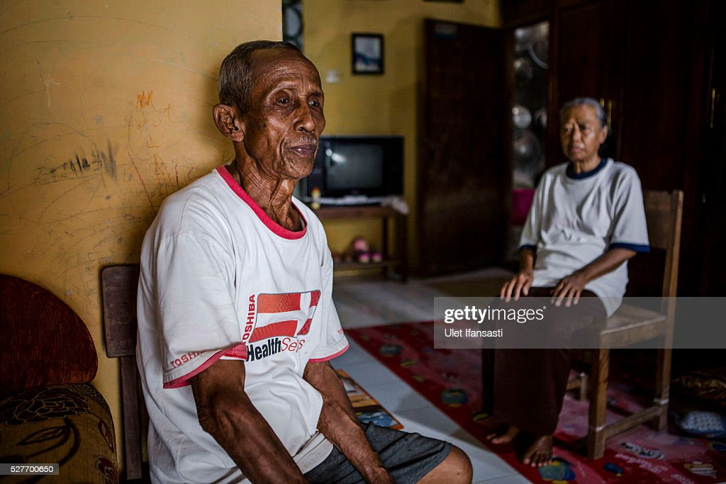 Sukar 83 years old, a villager who witnessed Indonesia's anti-communist massacre, sits with his wife Ribut, 65, inside their house in Plumbon village on May 3, 2016 in Semarang, Central Java, Indonesia. Sukar was ordered to bury victims of the massacre, who all had suspected ties to the Indonesian Communist Party (PKI). Survivors of Indonesia's anti-communist massacres called for investigations into the country's purges, in which possibly half a million to one million people died beginning October 1965, during the crackdown by the Indonesian government and military after an attempted coup by suspected communists.
