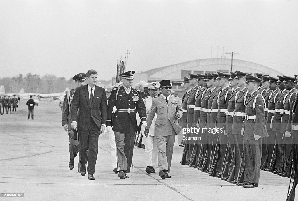 <a gi-track='captionPersonalityLinkClicked' href=/galleries/search?phrase=Sukarno&family=editorial&specificpeople=209275 ng-click='$event.stopPropagation()'>Sukarno</a> inspects honor guard. Andrews Air Force Base, Md.: Indonesian President <a gi-track='captionPersonalityLinkClicked' href=/galleries/search?phrase=Sukarno&family=editorial&specificpeople=209275 ng-click='$event.stopPropagation()'>Sukarno</a> (right) inspects the honor guard following his arrival here today for talks with President Kennedy. Trooping the line with him are President Kennedy and Lieutenant Colonel Charles P. Murray Jr., commander of the troops.