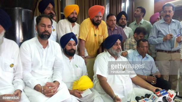 Sukhbir Singh Badal interacting with media along with Bikram Singh Majithia who is holding turban of AAP MLA which later handed over to him at GMCH...