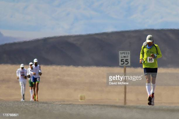 Sukhee Park of South Korea and other runners are seen among heat waves several miles from the start of the AdventurCORPS Badwater 135 ultramarathon...