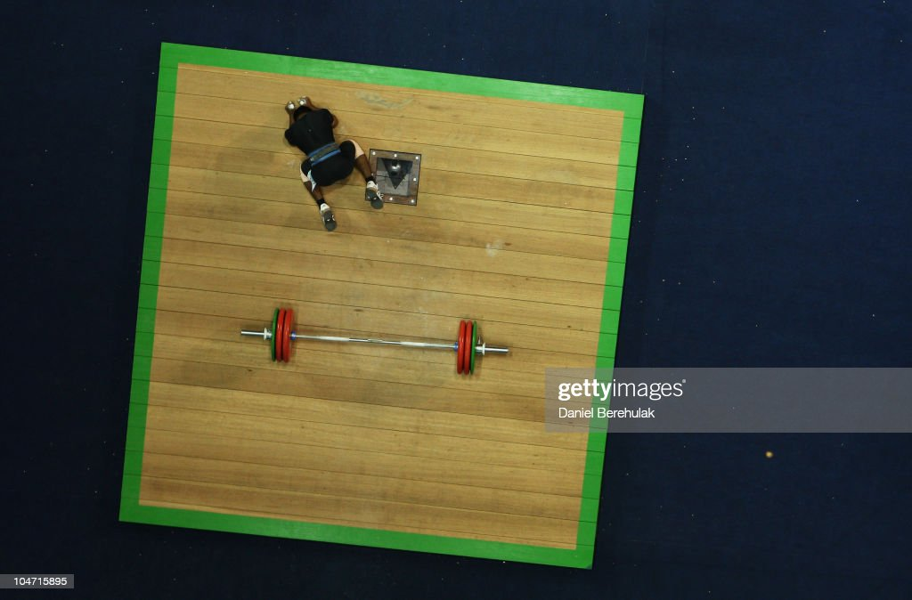 Sukhen Dey of India reacts after a failed attempt in the Mens 56 kg weightlifting final during day one of the Delhi 2010 Commonwealth Games at Jawaharlal Nehru Sports Complex on October 4, 2010 in Delhi, India.