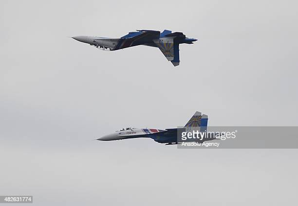 Sukhoi 27 jets of the Russian Knights aerobatic team perform a show during opening ceremony of The International Army Games 2015 on Alabino Range in...