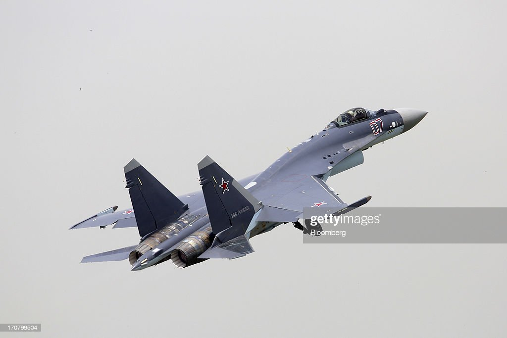 A Sukhoi Co. Holding OAO SU-35 fighter jet performs in a flying display on the second day of the Paris Air Show in Paris, France, on Tuesday, June 18, 2013. The 50th International Paris Air Show is the world's largest aviation and space industry show, and takes place at Le Bourget airport June 17-23. Photographer: Chris Ratcliffe/Bloomberg via Getty Images