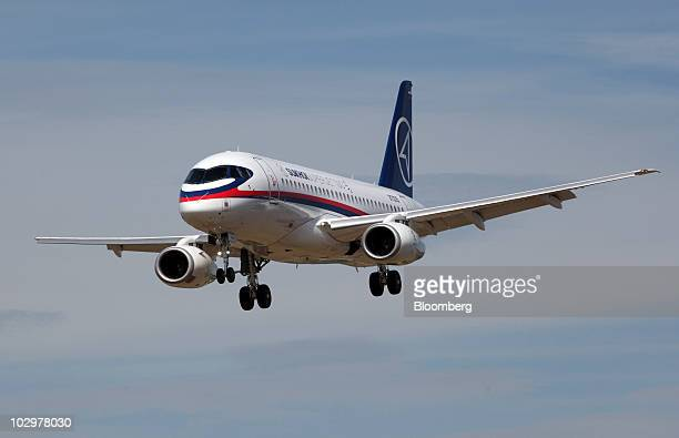 A Sukhoi Company Superjet 100 airplane flies on the first day of the Farnborough International Airshow in Farnborough UK on Monday July 19 2010 The...