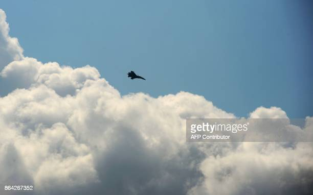 A Sukhoi fighter jet flies during an Air show on the occasion of 85th anniversary of the Indian Air force at Bamhrauli air force Station in Allahabad...