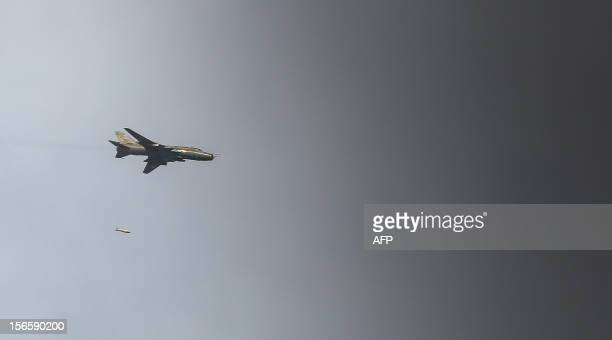 Sukhoi22 fighter jet of the Syrian air force drops a 500lb freefall bomb over the town of Maraat alNuman on November 17 2012 After months of repeated...