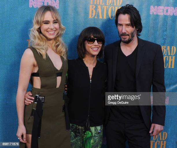 Suki Waterhouse Ana Lily Amirpour and Keanu Reeves arrive at the premiere of Neon's 'The Bad Batch' at Resident on June 19 2017 in Los Angeles...