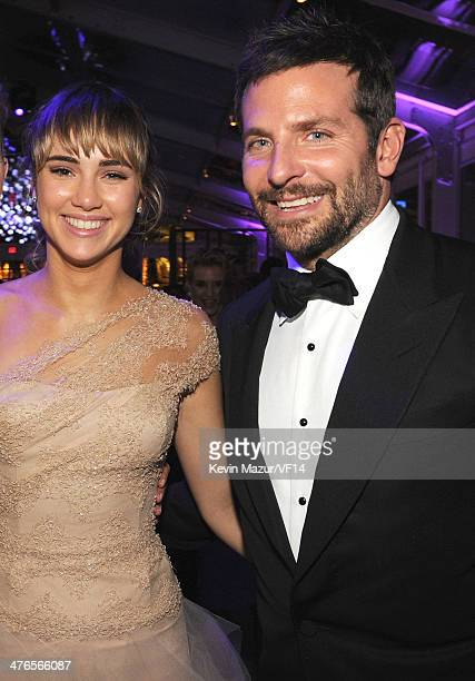 Suki Waterhouse and Bradley Cooper attend the 2014 Vanity Fair Oscar Party Hosted By Graydon Carter on March 2 2014 in West Hollywood California