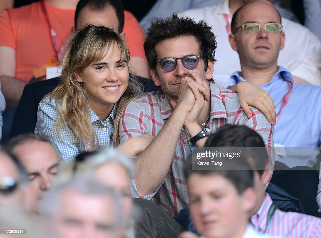 <a gi-track='captionPersonalityLinkClicked' href=/galleries/search?phrase=Suki+Waterhouse&family=editorial&specificpeople=7591336 ng-click='$event.stopPropagation()'>Suki Waterhouse</a> and <a gi-track='captionPersonalityLinkClicked' href=/galleries/search?phrase=Bradley+Cooper&family=editorial&specificpeople=680224 ng-click='$event.stopPropagation()'>Bradley Cooper</a> attend the Jerzy Janowicz vs Andy Murray match on Day 11 of the Wimbledon Lawn Tennis Championships at the All England Lawn Tennis and Croquet Club on July 5, 2013 in London, England.
