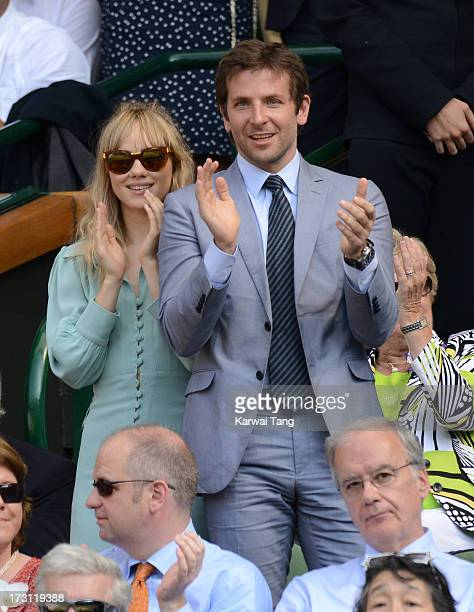 Suki Waterhouse and Bradley Cooper attend the Mens Singles Final on Day 13 of the Wimbledon Lawn Tennis Championships at the All England Lawn Tennis...