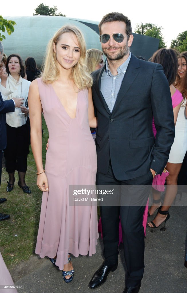 <a gi-track='captionPersonalityLinkClicked' href=/galleries/search?phrase=Suki+Waterhouse&family=editorial&specificpeople=7591336 ng-click='$event.stopPropagation()'>Suki Waterhouse</a> (L) and <a gi-track='captionPersonalityLinkClicked' href=/galleries/search?phrase=Bradley+Cooper&family=editorial&specificpeople=680224 ng-click='$event.stopPropagation()'>Bradley Cooper</a> attend The Serpentine Gallery Summer Party co-hosted by Brioni at The Serpentine Gallery on July 1, 2014 in London, England.