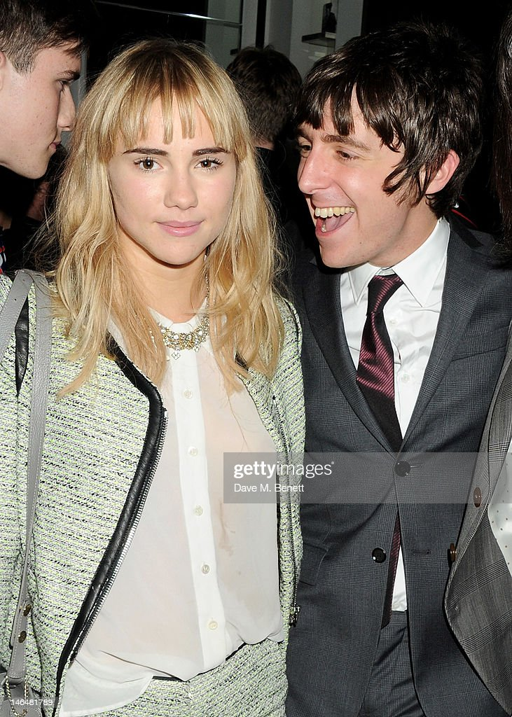 Suki Waterhouse (L) and <a gi-track='captionPersonalityLinkClicked' href=/galleries/search?phrase=Miles+Kane&family=editorial&specificpeople=4860678 ng-click='$event.stopPropagation()'>Miles Kane</a> attend as Christopher Bailey and Eddie Redmayne host a cocktail party to celebrate Burberry as part of the first London Collections: Men at the Burberry Knightsbridge store on June 17, 2012 in London, England.