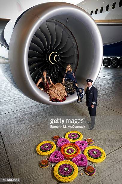 Suki Waterhouse and Neelam Gill pose with pilot Suneil Banerjee and a traditional Rangoli created by Bellapetals during a photo shoot to mark the...