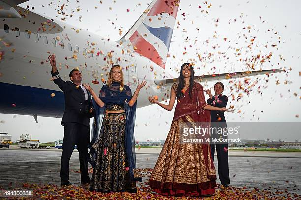 Suki Waterhouse and Neelam Gill pose with pilots Suneil Banerjee and Caitlin Emery during a photo shoot to mark the launch of flights by the new...