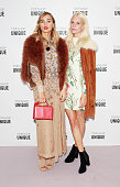 Suki Waterhouse and Poppy Delevingne arrive at the Topshop Unique show during London Fashion Week SS16 at The Queen Elizabeth II Conference Centre on...
