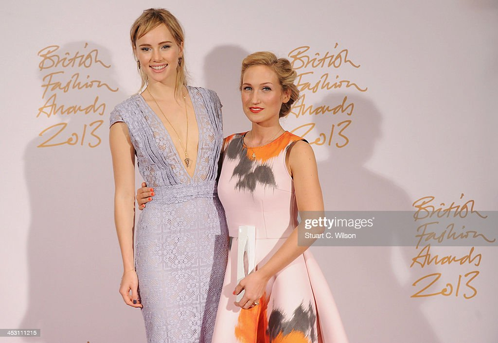 Suki Waterhouse and Sophia Webster with the Emerging Accessories Designer Award poses in the winners room at the British Fashion Awards 2013 at London Coliseum on December 2, 2013 in London, England.