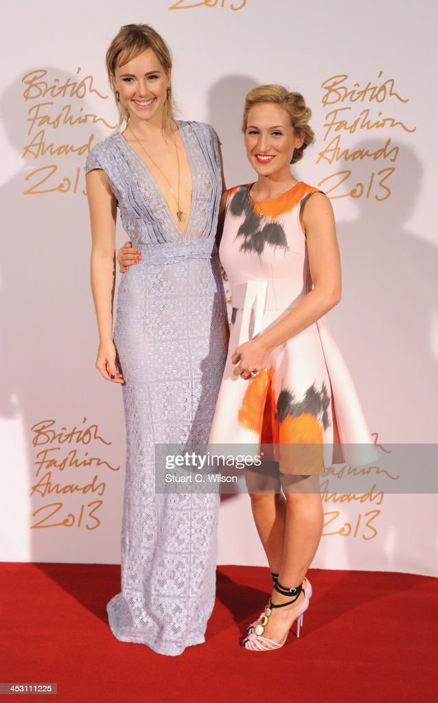 Suki Waterhouse (L) and Sophia Webster with the Emerging Accessories Designer Award poses in the winners room at the British Fashion Awards 2013 at London Coliseum on December 2, 2013 in London, England.