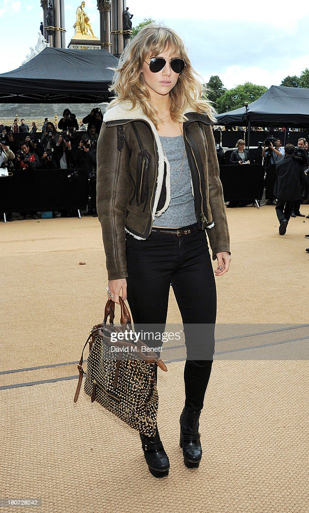 Suki Waterhouse arrives at Burberry Prorsum Womenswear Spring/Summer 2014 show during London Fashion Week at Kensington Gardens on September 16, 2013 in London, England.