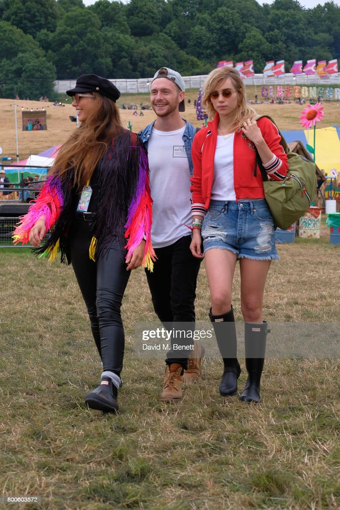 Suki Waterhouse (R) attends day two of Glastonbury on June 24, 2017 in Glastonbury, England.