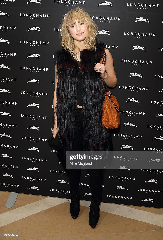 <a gi-track='captionPersonalityLinkClicked' href=/galleries/search?phrase=Suki+Waterhouse&family=editorial&specificpeople=7591336 ng-click='$event.stopPropagation()'>Suki Waterhouse</a> attends the grand opening party of Longchamp Regent Streetat Longchamp on September 14, 2013 in London, England.